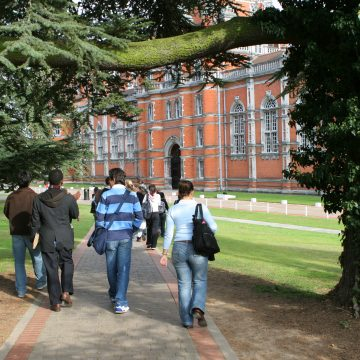 group of students walking to university building